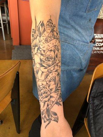Elaborate tattoos on waitresses arm
