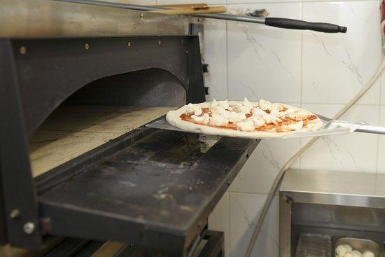 Приготовление пиццы в A Milano