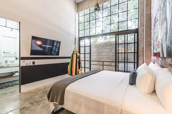 Lofts On Basilio: Loft 202, opens to the rear waterfall. This is a 2 bedroom loft that has 2 king beds.