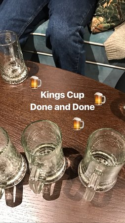 Fun in our hotel lobby bar playing Kings Cup