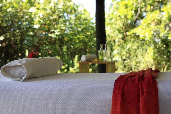 A full body massage in front of Playa Las Lajas, next to Las Lajas Beach Resort.