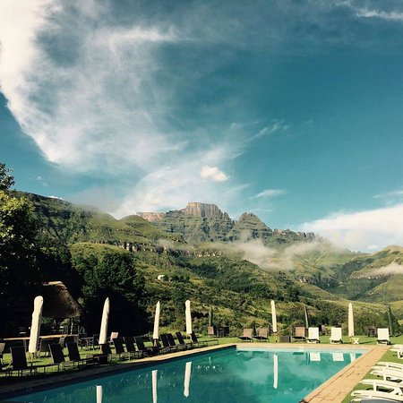 Our swimming pool as plenty of room for guests to relax and unwind, with the beautiful mountains as a backdrop