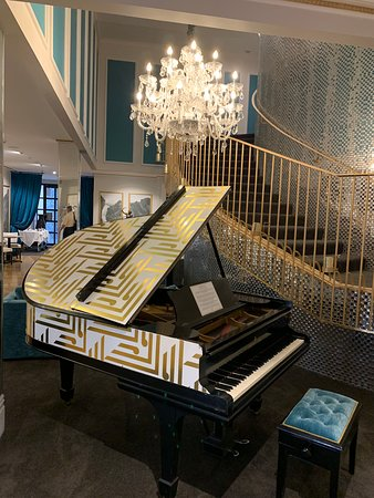 A grand piano in the lobby of the Queenstown Sofitel