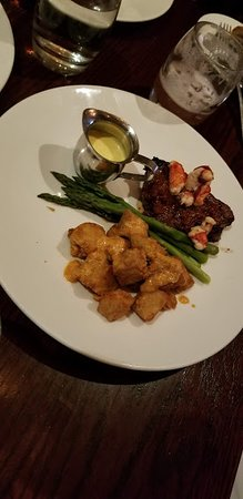 The Keg Steakhouse + Bar Mansion: Steak with lobster and crusted potatoes