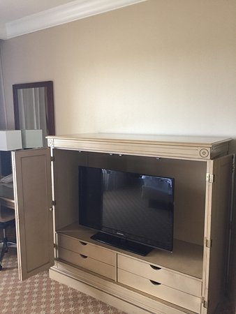 I wonder where the hotel could place a flat screen TV on a wall that would allow guests lying in bed to actually see the screen?  Giant entertainment center from the 1980's-1990's designed for box TV that is used to house undersized, too low TV.   Duh!