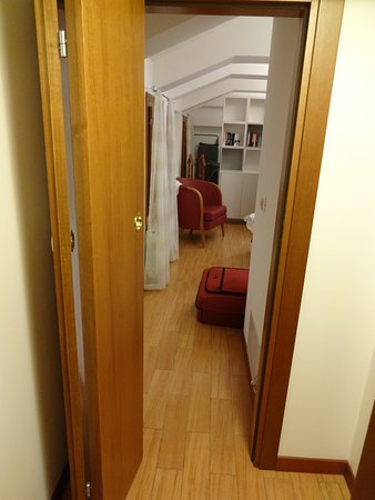 looking from the shared bathroom to the bedroom #2 (with single bed)