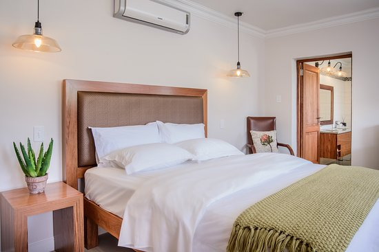 Size: 28m2 Bed size: Queen extra length. Bathroom: Separate bathroom with special Swiss jet shower, no bath Location: Main lodge building, down stairs. Other: Small balcony, full floor tiles. Close to front doo