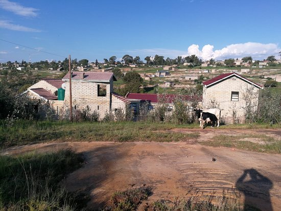 Teyateyaneng, Lesotho: This is our front view of the property. It is situation in a sloppy terrain with natural green surroundings. The building is sitting on the nice sand stone foot print and is also constructed out of the sand stone.