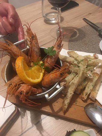Gambas Algarve style with orange and garlic