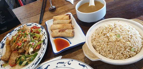 Salt and pepper king prawns, veg spring rolls, egg fried rice and curry sauce.