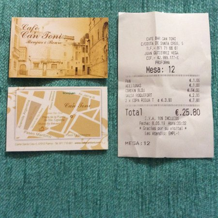 Cafe Ca'n Toni: Business card and receipt for two people including wine. Helpings of food generous. EUR 25.80. Incredible value.