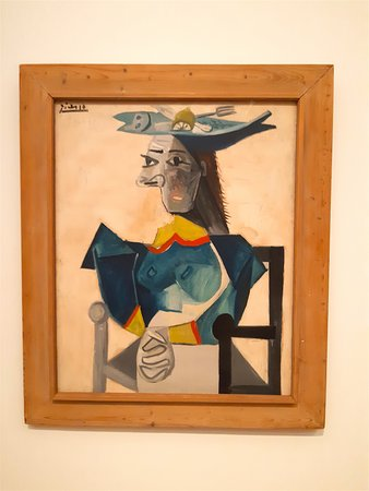 Pablo Picasso - Seated Woman with Fish-Hat, 1942