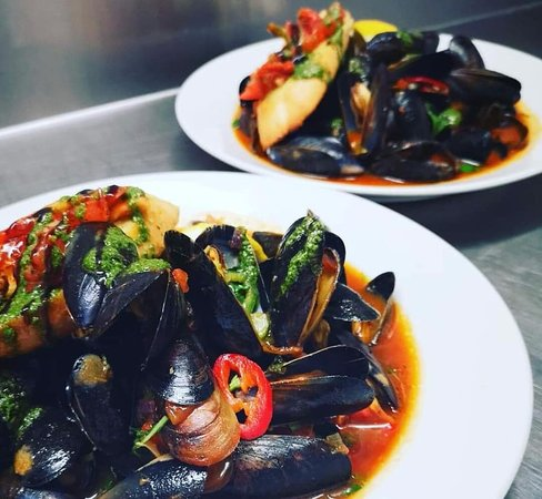 Fresh Local Mussels & House basil infused tomato sauce, served with a garlic croute