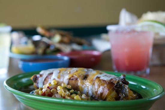 Plenty of vegetarian options, such as this house specialty, our Butternut Squash Enchilada topped with Peanut Sauce.