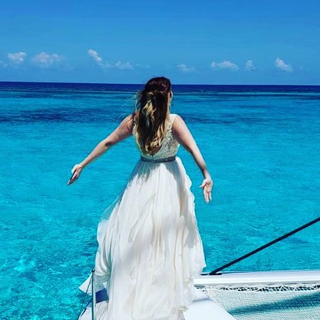 Cayman Yacht Charters: Wedding Party cruise aboard Catch the Cat Grand Cayman. Queen of the world now!