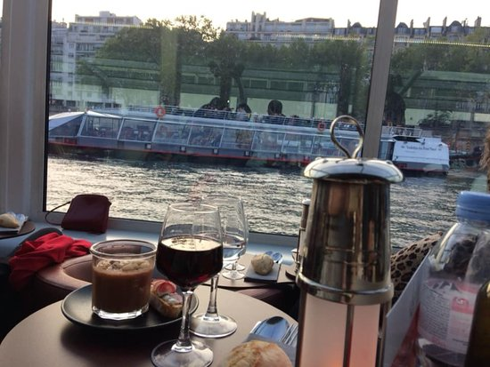 Seine River Bistro-Style Dinner & Sightseeing Cruise on board Paris en Scene: Greeting the guests in the other dinner boat