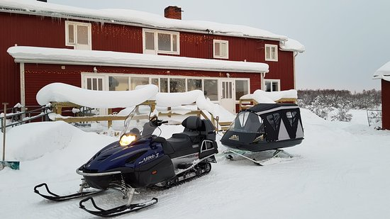 Lapland Sweden, Sweden: Guests can get out into the forest or follow the frozen river on our snowmobile and large Pulka. Enjoy some food cooked over an open fire.