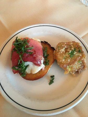 Eckhard's: A shared plate of Baked Fresh Mozzarella wrapped in Prosciutto Ham over Crostini Bread and Artichoke Hearts A la Don.  An order of each comes with 2 proschuitto and 4 artichoke hearts.