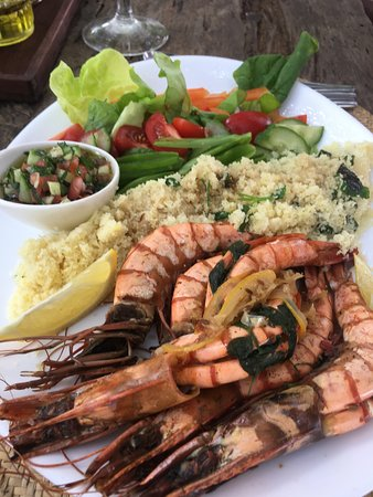 Kijani Rooftop Restaurant & Bar: grilled king prawns and couscous 