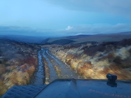 90 Dirty Adventures: A the sun goes down and the light fades, our decent into the valley is floodlit with LED's.