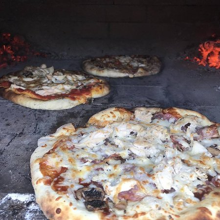 Wood fired stove cooking homemade pizzas
