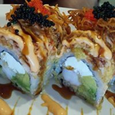 Sino 1 Chinese and Sushi Restaurant: Pear blossom Roll. TOP SELLER. Tempura shrimp.cheese,krabmeat,avocado and special krebmeat on the top.