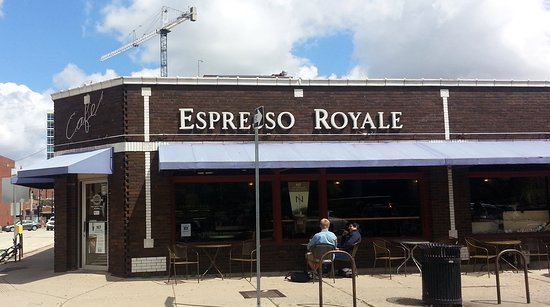 Espresso Royale Cafe: entrance and sidewalk seating on E. Daniel St.