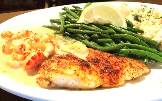 Red Snapper with house made craw fish sauce served with green beans and potato salad