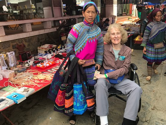 Me and a woman who insisted on giving me one of her woven bracelets dues to my disability at Bac Ha Market.