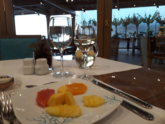 Fresh fruit with wine and water in sparkling clean glasses - Main Restaurant