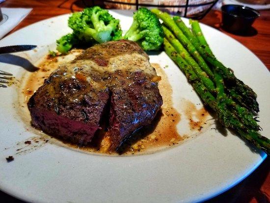 Cajun sirloin steak with broccoli and asparagus.
