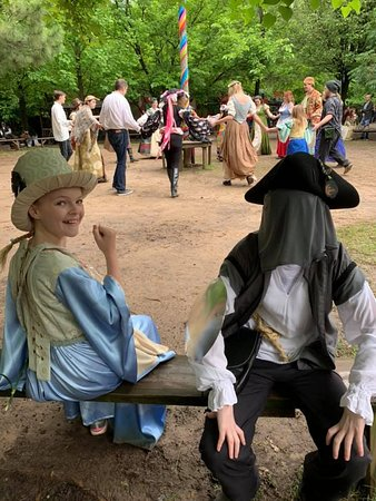 The kids in costume near the Maypole.