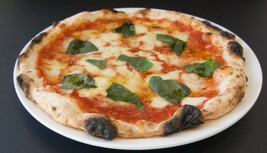 Zazz Pizza: A freshly baked Margherita Pizza is one of our top sellers. A classic pizza with fresh basil and mozzarella on our home made tomato base.