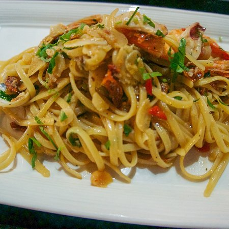 Zazz Pizza: Seafood Aglio Olio - Simplicity at its best! Linguine tossed in olive oil flavoured with chili, garlic and sundried tomatoes with mixed seafood  A vegetarian version of this dish is also available and is vegan friendly