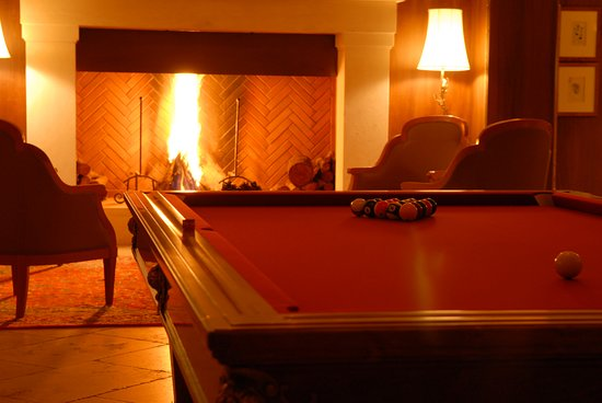 Our pool table and a fig fireplace will welcome in taverna