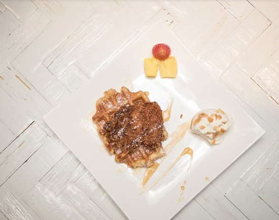Chicken & Waffle from the Small Plates menu. Fried chicken, maple syrup, and amaretto cream.