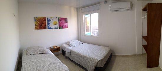 Département de San Andres et Providencia, Colombie: Habitacion Secundaria dotada con 2 camas sencillas y aire acondicionado.