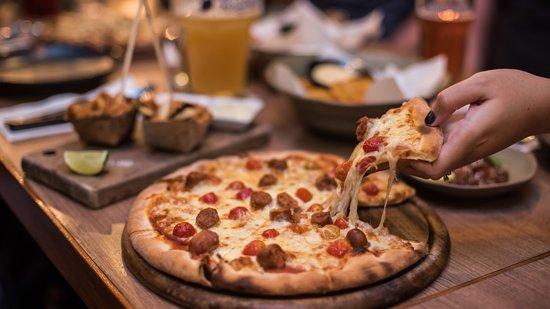 De-li-cious Merquez Sausage Pizza