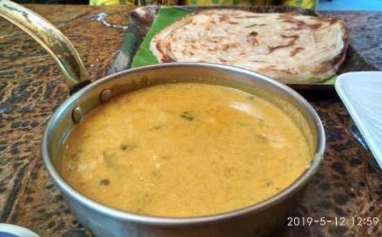 Delicious Kurma served with crisp Malabari Parottas