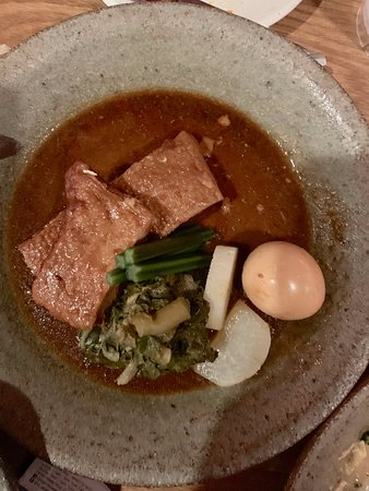 Pork belly with spinach, egg and potato