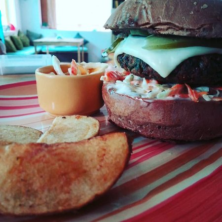 Crispy Spinach Quinoa Burger, served with coleslaw and crispy potato wedges