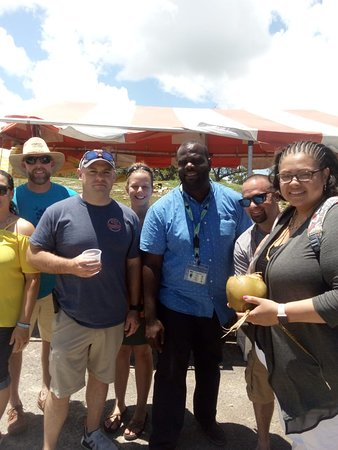 Nassau, New Providence Island: Drinking nice cold coconut water at the vegetable market