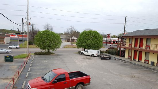 Deluxe Inn Lodging: Clean, Secured, Spacious Lot.