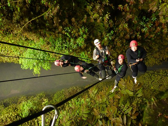 Waitomo Adventures: Repelling 100meters down to the Cave entrance.