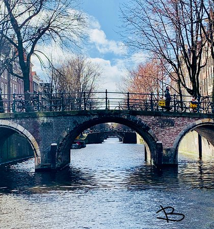After some amsterdam coffee, take a stroll around the corner of Tweede Kamer Coffeeehsop...take a right, cross the bridge into the alley and left on the second Canal. Here you find this fairy tail scene of the Canal with the beautiful arches ...