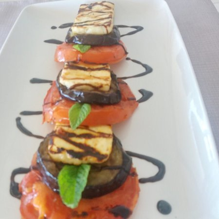 Tomatoes aubergine and cheese