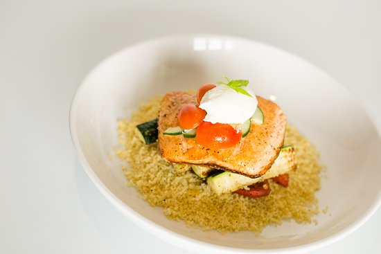 Neptune's Taphouse and Eatery: Seared Salmon: Light and fresh North Atlantic salmon on a bed of couscous and zucchini, roasted red peppers, topped with tomato-cucumber salad and creme fraiche.