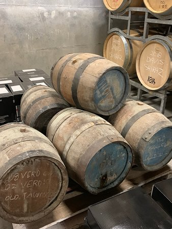 VIP Swan Valley Wine Tour: Premium Small-Group Wine and Gourmet Experience: Boutique vineyard with varying sizes of oak barrels for aging wine