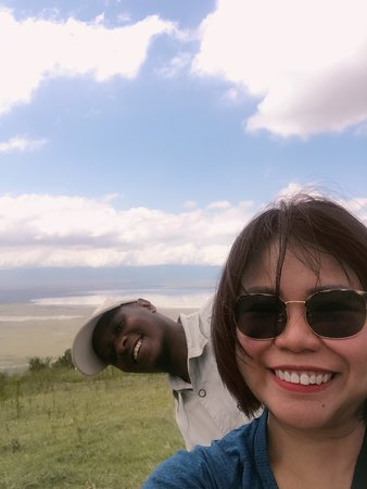 Elyon Tour guide Amani showing me The Caldera, a stunning view of the Ngorongro crater