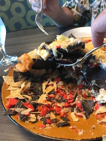 I think they gave us the bottom of the bag of chips for our Nachos. They did offer to take 10% off the bill. They deducted $1.45 off the bill. Sheesh!